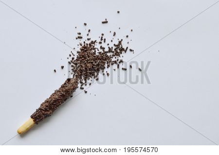 chocolate coated bread sticks on white background