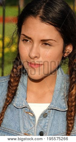 Girl Teenager And Confusion with Long Braided Hair