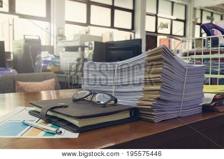 Concept Of Document Workload, Pile Of Unfinished Documents On Office Desk, Stack Of Business Paper,