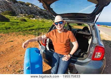 Summer, holiday, trip and vacation concept - Man near the car ready to travel.