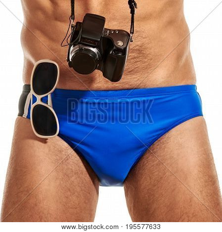 Close up of male athletic swimmer with accessories for underwater photography
