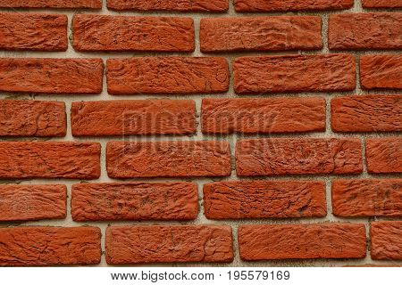 Bright texture of red bricks on the wall of the building