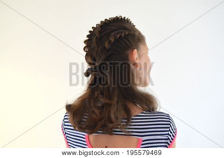 Hairstyle for medium length hair - a young girl on a white background