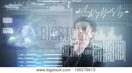 Thoughtful businessman analyzing data on more touch screens