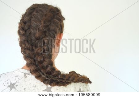 Hairstyle with long hair - young girl on a green background