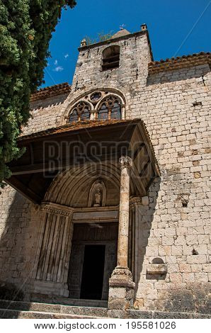View of the front facade of the church Notre-Dame de Beauvoir, above the charming village of Moustiers-Sainte-Marie. In the Alpes-de-Haute-Provence department, Provence region, southeastern France