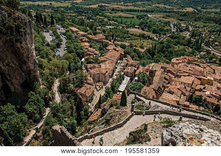View of stone staircase, roofs and belfry in the charming village of Moustiers-Sainte-Marie. In the Alpes-de-Haute-Provence department, Provence region, southeastern France. Retouched photo