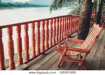 wood chaise longue at the wood balcony Along the Mekong River Laos Color Retro Style