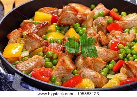 Fried Meat With Green Peas, Onion, Bell Peppers