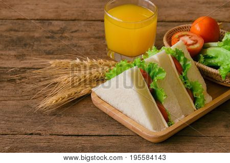 Piece Of Sandwich Ham Cheese With Lettuce And Tomato On Wood Plate. Homemade Sandwich Served With Or