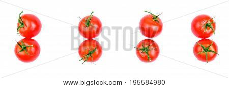 Ripe, raw, juicy, fresh, healthy, organic bright red tomatoes with green leaves, isolated on a white background. A lot of cherry tomatoes. Organic tomatoes for a salad. Set of fresh tomatoes, top view. Summer harvest from a garden.