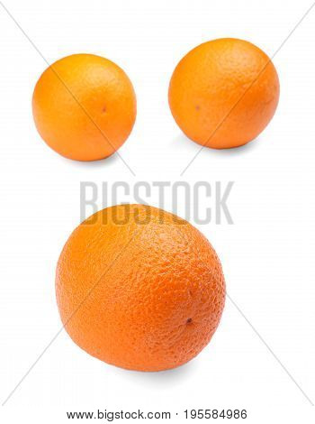 Three tropical and exotic, healthy oranges, isolated on a white background. Organic, fresh and bright orange vitamins. Ripe citrus fruits. The composition of the three ripe oranges. Citrus fruits.