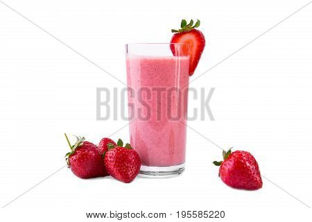 A transparent glass of strawberry smoothie, isolated on a white background. Strawberry yogurt with ripe berries and organic milk in a glass and fresh strawberries around. Yogurt with fresh berries.