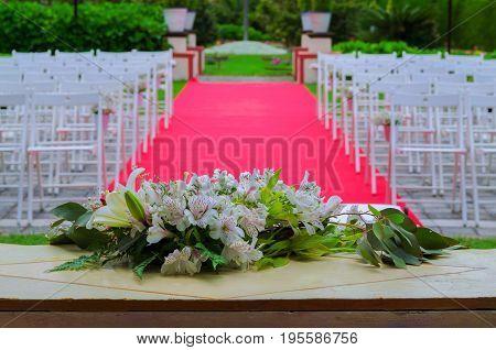 Beautiful Wedding Ceremony Decoration, Rustic Altar Decorated With Lilies, Alstroemerias And Chrysan