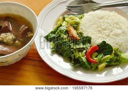 stir fried Chinese kale sprout with crispy pork and ivy gourd soup