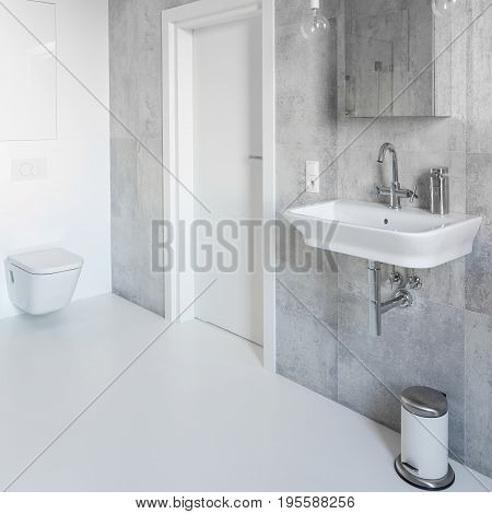 Spacious gray and white bathroom with modern decor