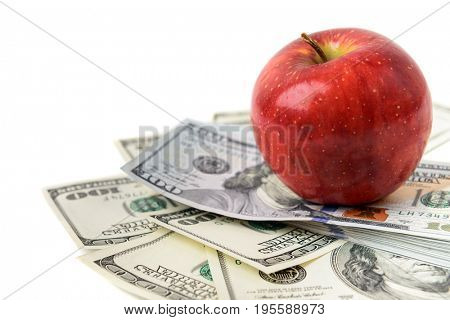 Dollars with red apple isolated on white