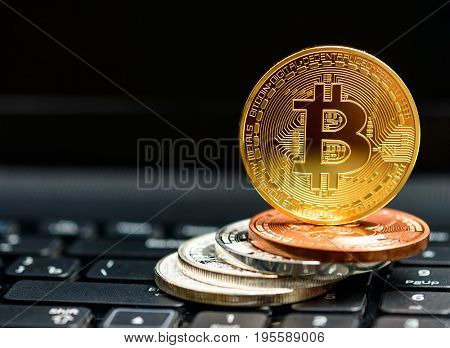 bitcoin coins on black keyboard