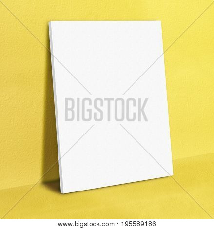 Blank White Poster Canvas Frame Leaning At Yellow Concrete Paint Wall And Floor, Mock Up Template Fo