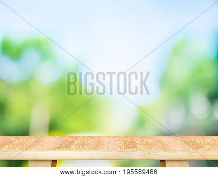 Empty Modern Brown Wood Table Top With Sun And Blur Green Tree Bokeh Background, Template Mock Up Fo