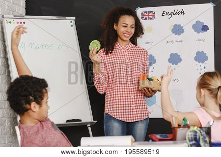 Young pretty woman as a teacher on english classes
