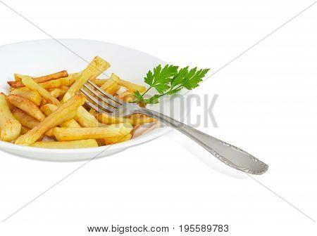 Fragment of the white dish with the French fries and twig of parsley and fork of stainless steel on a light background