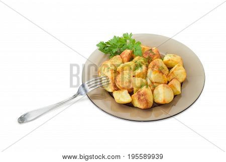 Serving of the country style fried potatoes sprinkled by chopped dill and twig of parsley on dark glass dish and fork on a light background