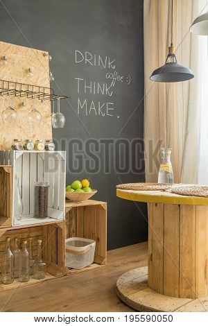 Upcycled interior with blackboard and DIY furniture