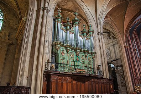 Aix-en-Provence, France - July 09, 2016. Organ at Aix Cathedral amid Gothic columns in Aix-en-Provence, a vivid city in the French countryside. Provence region, southeastern France