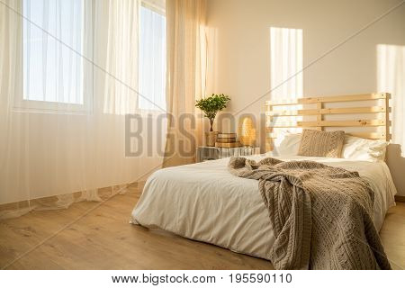 Bright hipster bedroom with upcycled wooden bed