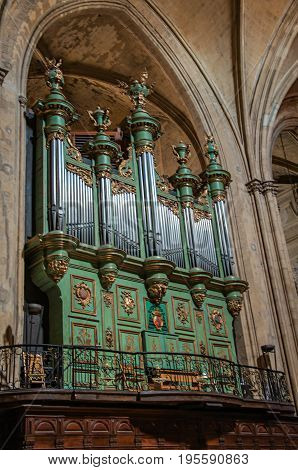 Aix-en-Provence, France - July 09, 2016. Organ at Aix Cathedral amid Gothic columns in Aix-en-Provence, a pleasant and lively town in the French countryside. Provence region, southeastern France