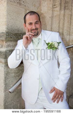 Happy Smiling Newlywed Rich Groom At Wedding Day. Elegant In Tuxedo Costume