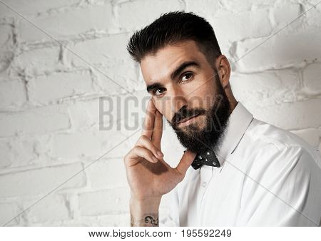 Thoughtful young bearded man portrait photo with copyspace.
