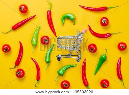 Above View At Chili Pepper And Shopping Cart