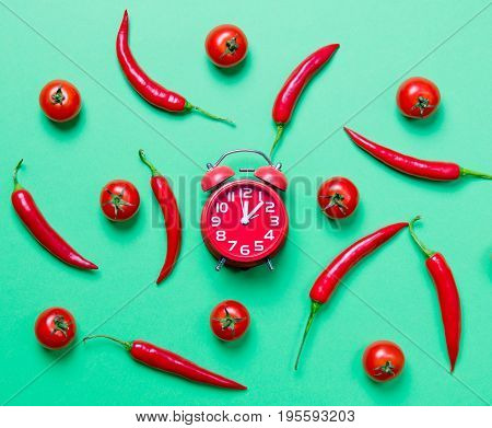 Above View At Chili Pepper And Alarm Clock With Tomatoes