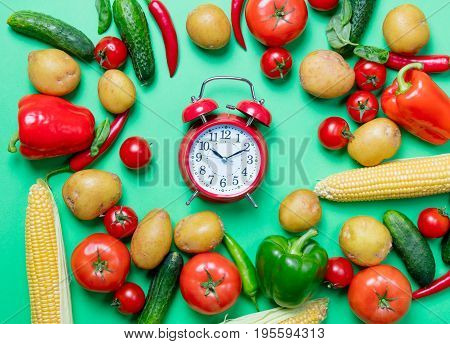 Tomatoes And Potatoes With Alarm Clock