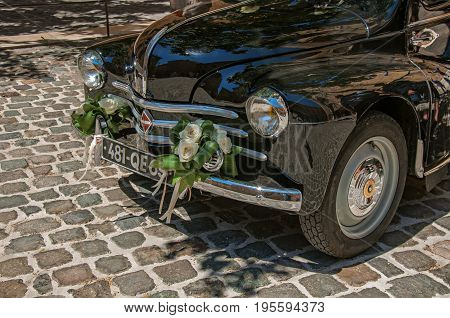 Aix-en-Provence, France - July 09, 2016. View of old model car for newlyweds in Aix-en-Provence, a pleasant and lively town in the French countryside. Provence region, southeastern France