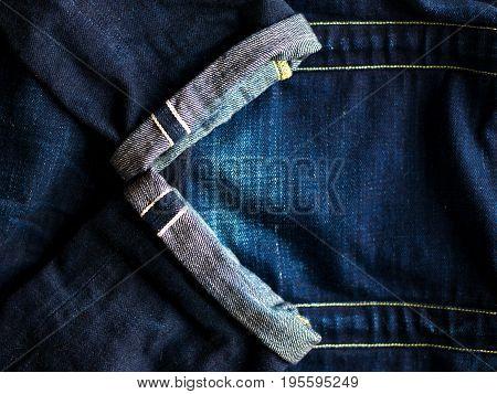 Raw Selvedge Denim put on fade denim jeans.