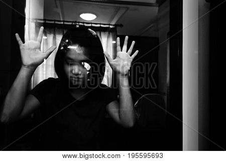 Depress And Hopeless Girl Standing Near Door , Put Hand On Mirror Door (abuse Concept)