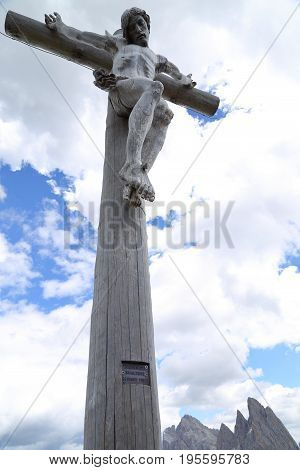 Wood Cross with crucified Christ in Seceda Dolomites