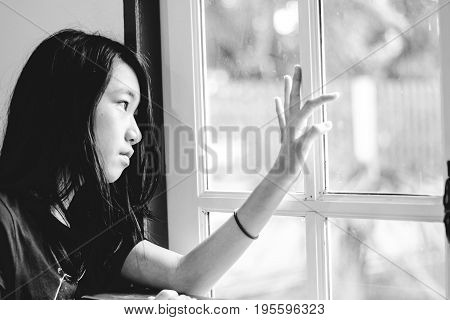 Depress And Hopeless Girl With Absent Minded Looking Outside
