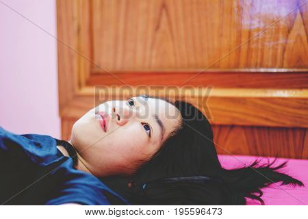 Girl Lay On Bed With Absent Minded
