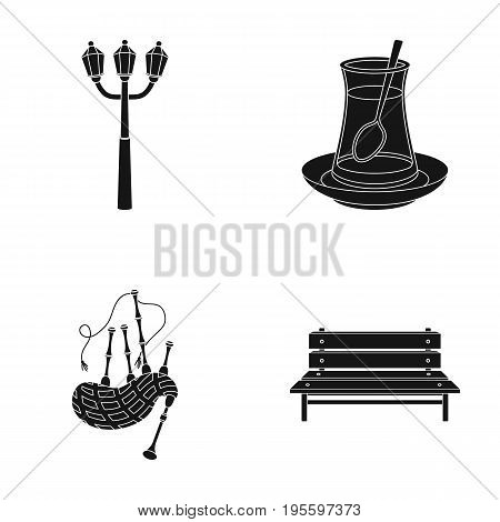 Street lamp, tea and other  icon in black style. bagpipe, bench icons in set collection.