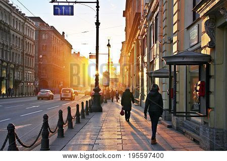 Saint Petersburg Russia - April 2015: Movement of business area in a the city that covering by golden light sun