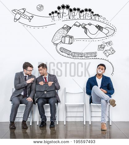 Businessmen Sitting On Chairs