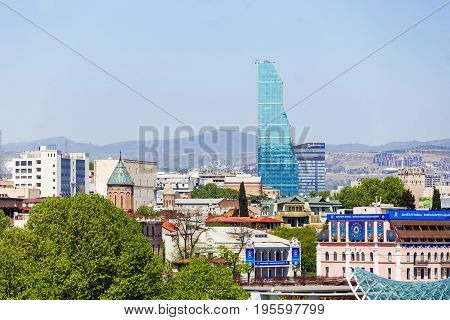 TBILISI GEORGIA - May 01 2017. Panorama view of Tbilisi. Modern landmark - Biltmore Hotel Tbilisi.