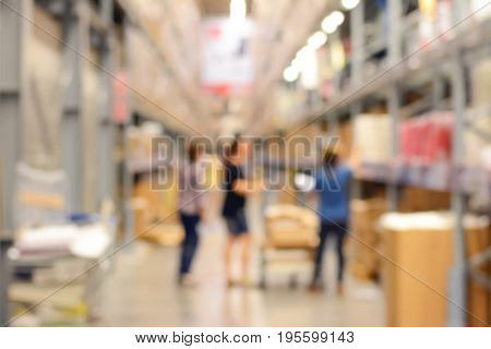 Blur warehouse or storehouse with some people
