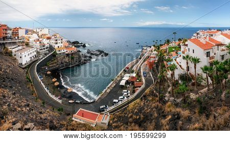 Panoramic aerial view of Chica beach in Puerto de Santiago in Los Gigantes Tenerife Canary Islands Spain.