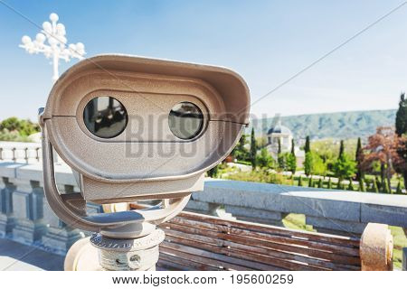 Binoculars for tourists on the view point near Sameba (Holy Trinity Cathedral of Tbilisi). Georgia country.