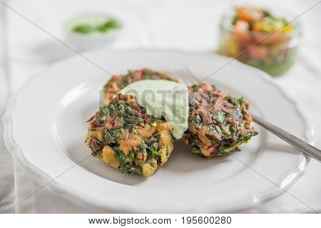 Delicious veggie burger patty with chard and a sour cream dip
